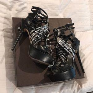 Black and Silver Bebe heels
